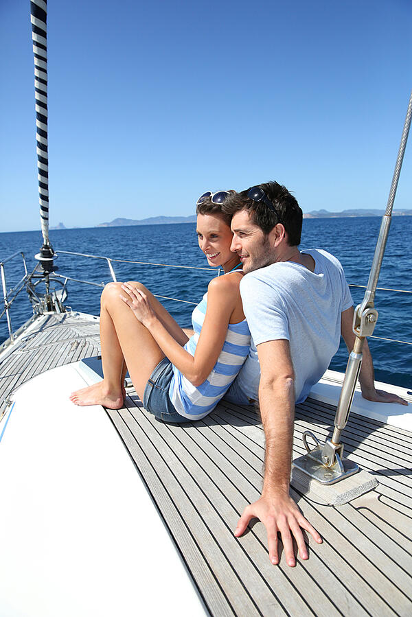 Couple stting on sailboat deck looking at sealine-1