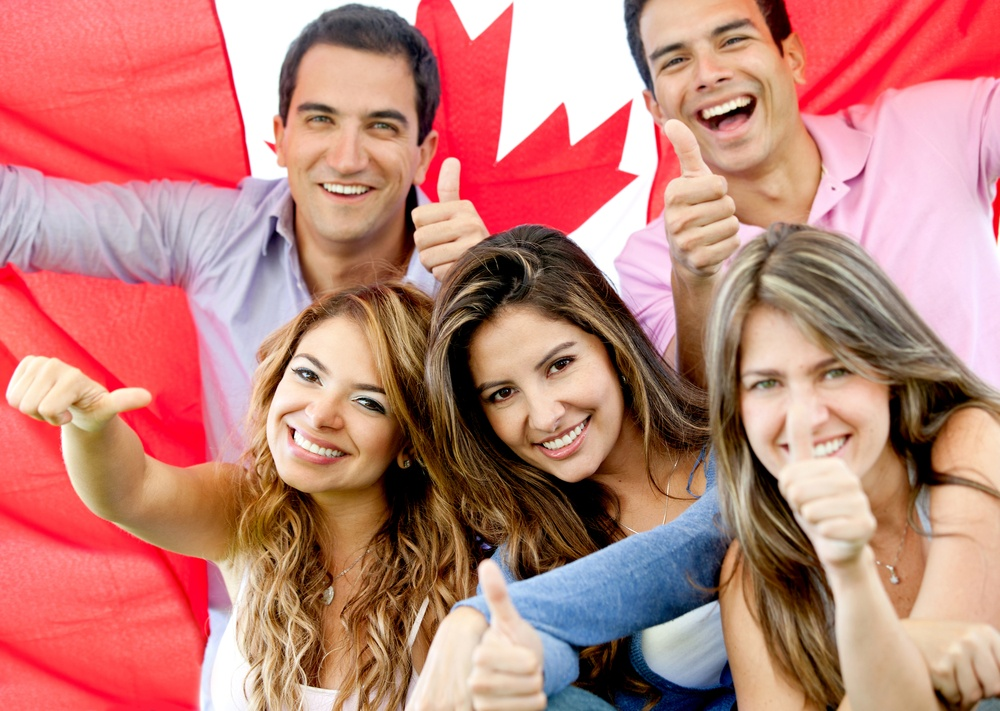 Group of young people with thumbs up and the flag of Canada-1