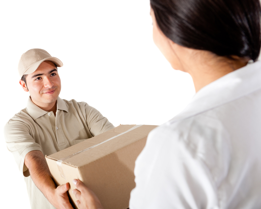 Man delivering a package - isolated over a white background