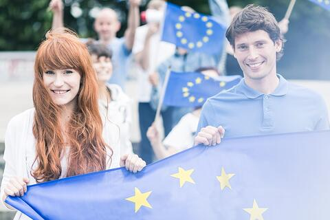 Picture of young community workers with european union flags-1