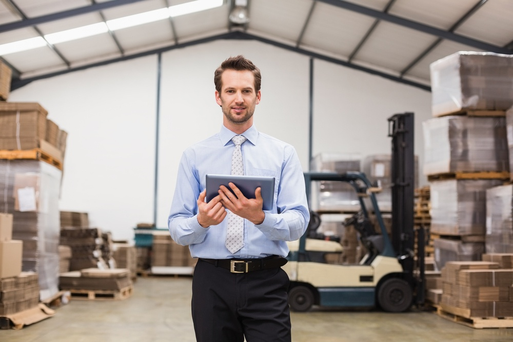 Portrait of male manager using digital tablet in warehouse-1