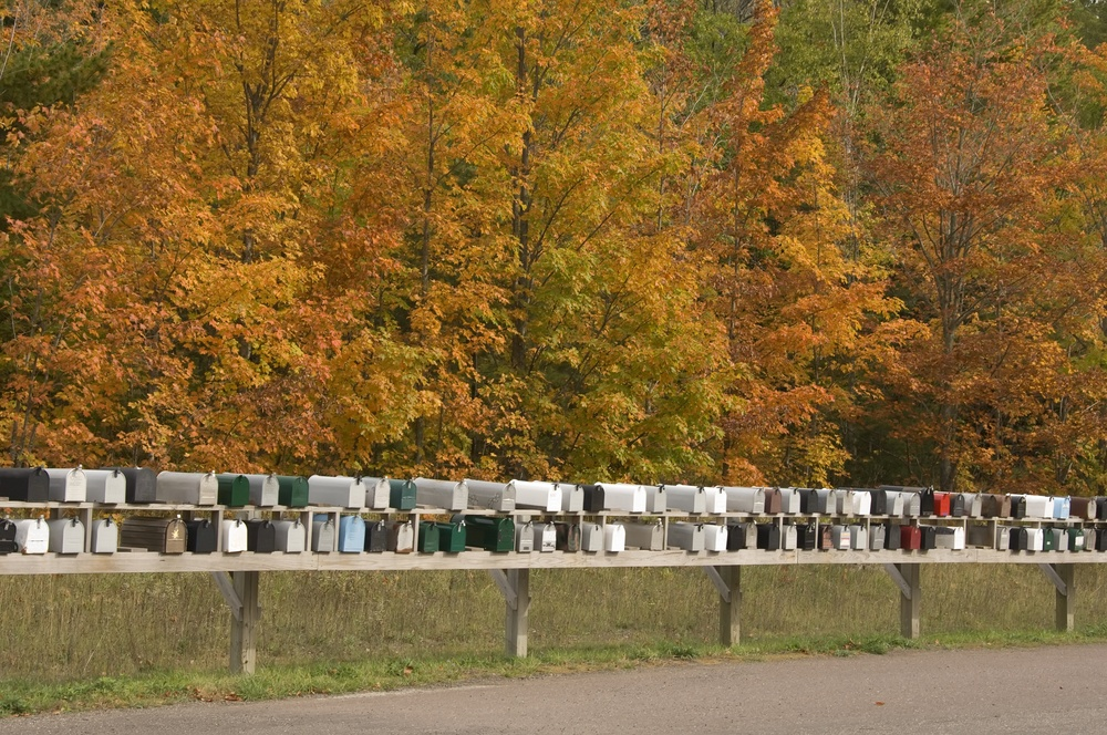 Row of mailboxes (identifiers removed) on a fall day in northern Michigan