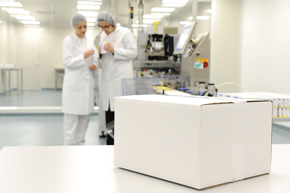 White box at automated production line at modern factory - ready for your logo