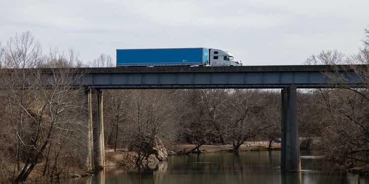 truck-crossing-bridge-over-water
