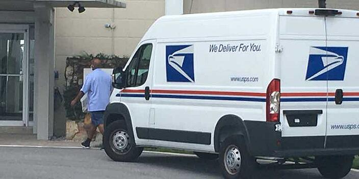 usps-delivery-van-post-to-apartments