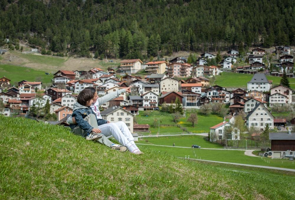 Boy and girl having beautiful spring vacation in idyllic Alps